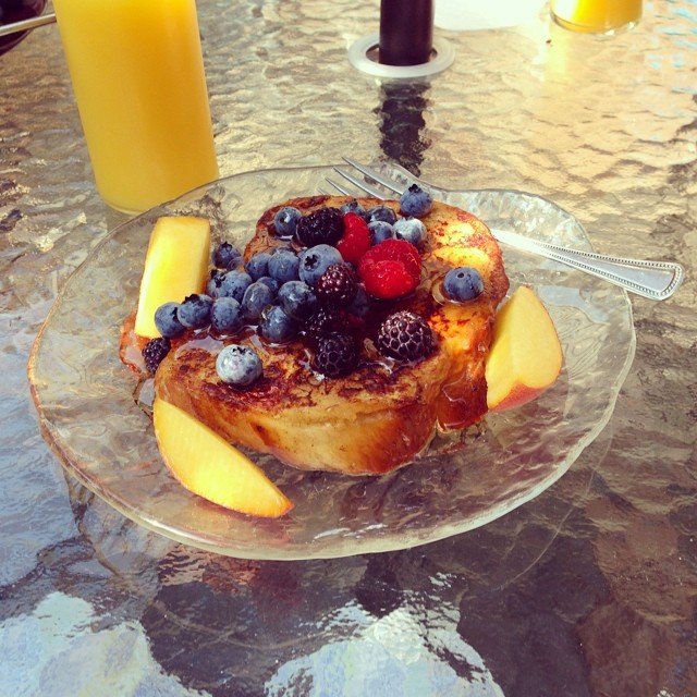 Summer breakfast on the patio: challah French toast & fruit from the farm/garden. <3