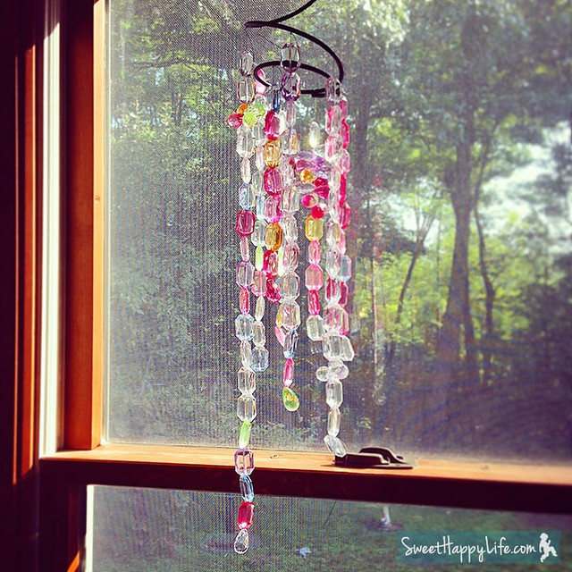 We made this pretty suncatcher for our dining room window. I love DIY decor! New post: http://bit.ly/WzmrhO
