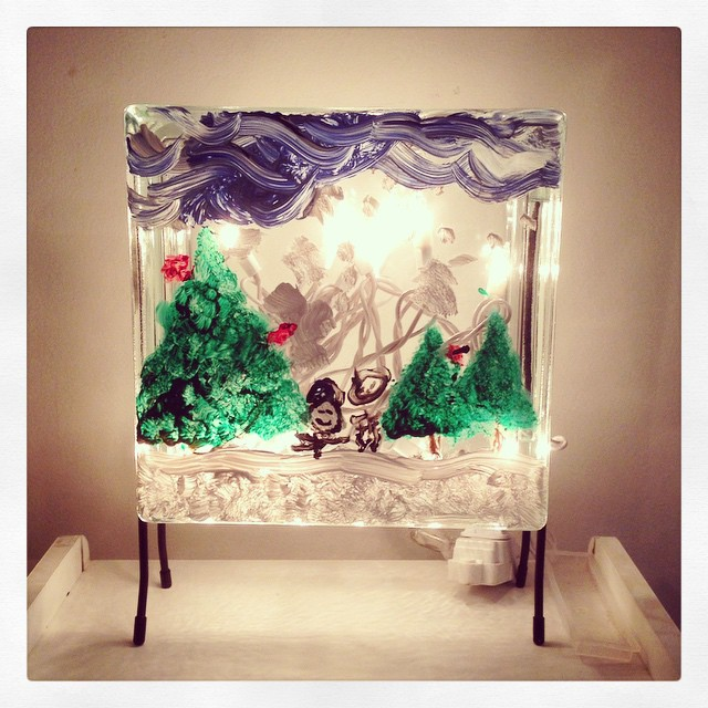 Made a winter themed holiday decoration today! That's the munchkin's art on a glass box filled with lights.